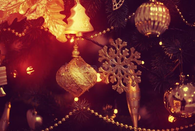 Beautiful glass ball on the Christmas tree. Beautiful glass ball and garlands on the Christmas tree royalty free stock photo