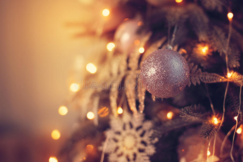 Beautiful glass ball on the Christmas tree. New Year holidays royalty free stock image