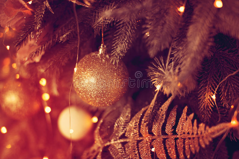Beautiful glass ball on the Christmas tree. New Year holidays royalty free stock photography