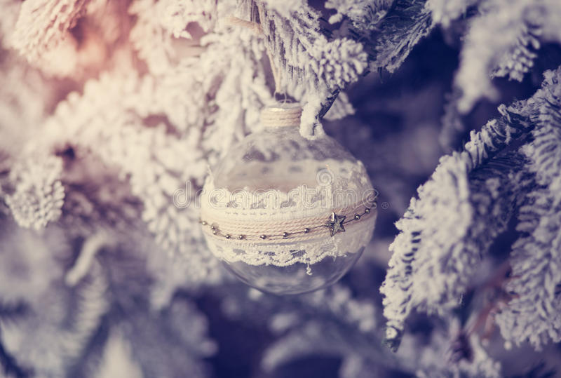 Beautiful glass ball on the Christmas tree. New Year holidays stock photography