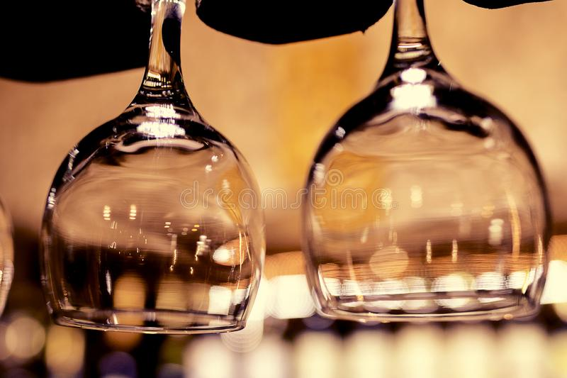 Beautiful glasses upside down from a bar stock photos