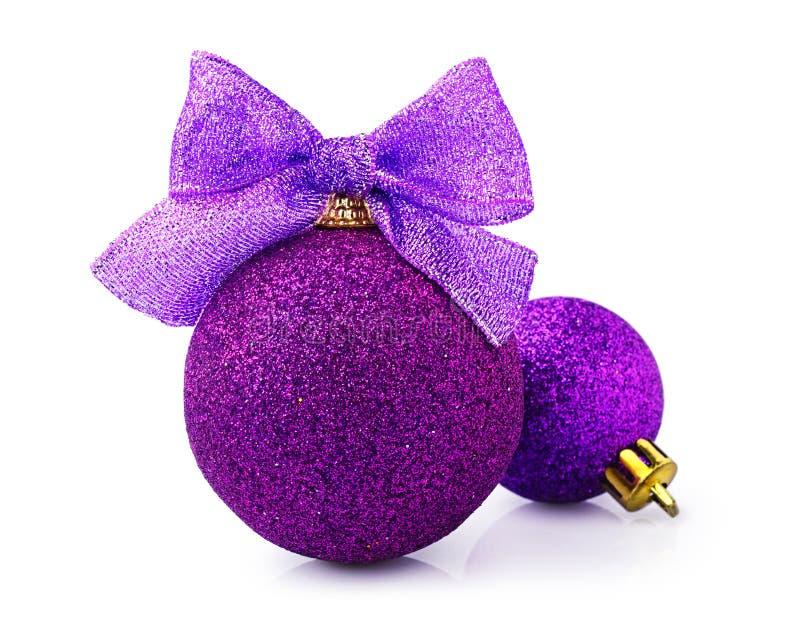 Beautiful glittering purple christmas balls with bright ribbon stock image