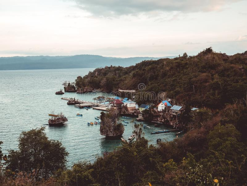 Beauty beach cliff. With clean sea water at sulawesi royalty free stock photography