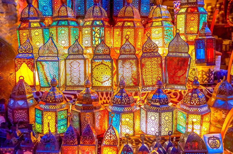 The glowing lanterns in Cairo, Egypt. The beautiful glowing arabian lanterns in different forms at famous lighting shop in Khan EL-Khalili market in Cairo, Egypt royalty free stock photography
