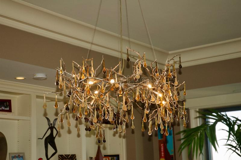 Beautiful Gold Chandelier in Luxury Penthouse Suite royalty free stock photography