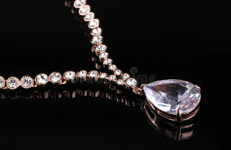 Beautiful gold necklace with jewels stock photography