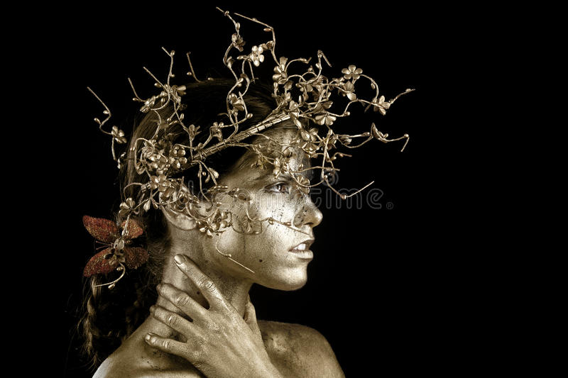 Beautiful Gold Painted Woman in Conceptual Beauty Themed Image royalty free stock images