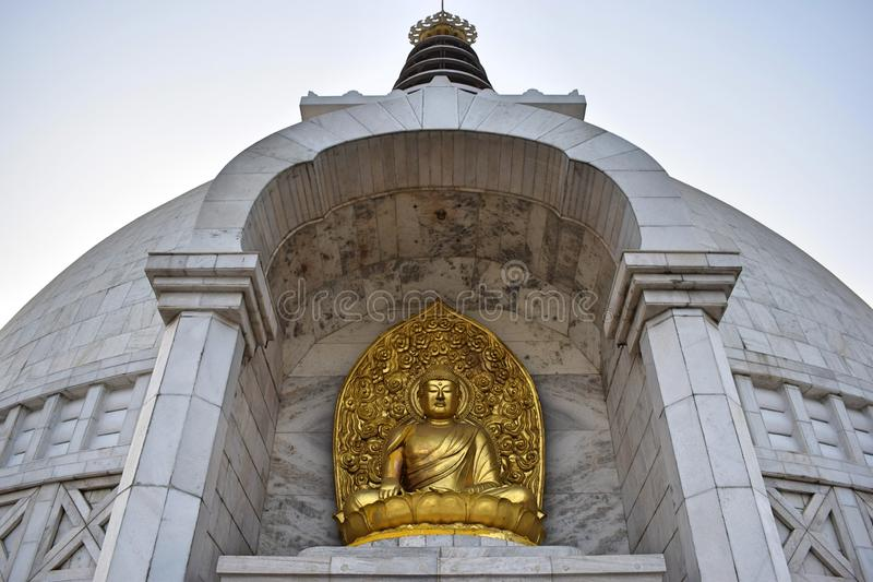 Beautiful Golden Buddha statue in Shanti Stupa Temple in Delhi. India royalty free stock images