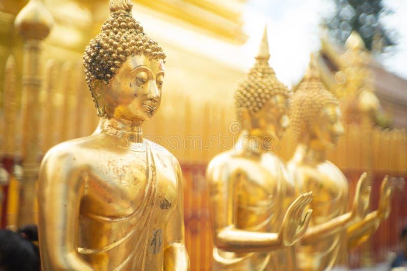 Beautiful golden Buddha stay around the pagoda at Wat Phra That Doi Suthep Temple, Chiangmai ,Thailand stock photography