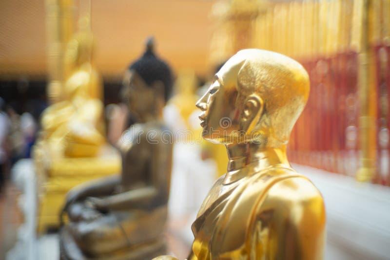 Beautiful golden Buddha stay around the pagoda at Wat Phra That Doi Suthep Temple, Chiangmai ,Thailand stock photo