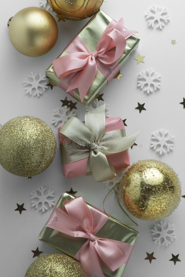 Beautiful golden gifts gloden baubles on white. Christmas, party, birthday background. Celebrate shinny surprise boxes copy space stock image