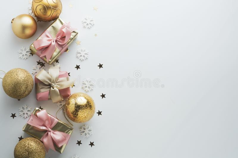 Beautiful golden gifts gloden baubles on white. Christmas, party, birthday background. Celebrate shinny surprise boxes copy space. Beautiful golden gifts baubles royalty free stock images