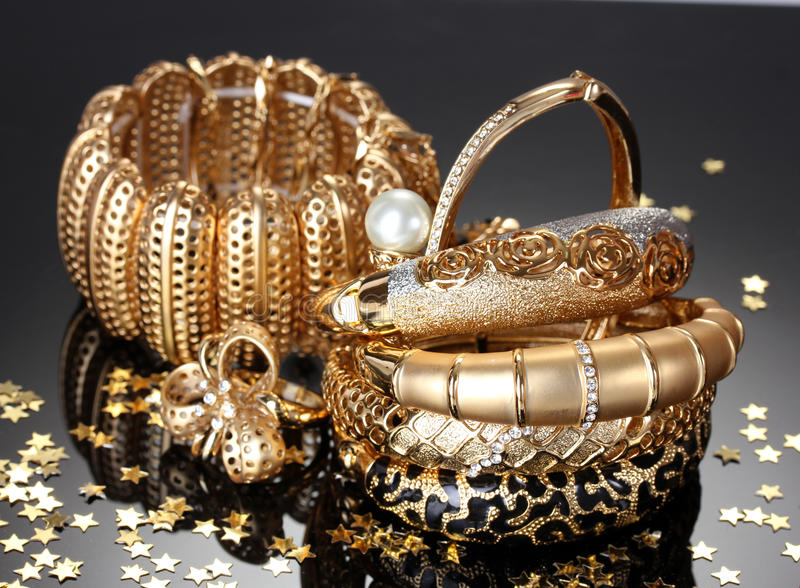 Beautiful golden jewelry royalty free stock images