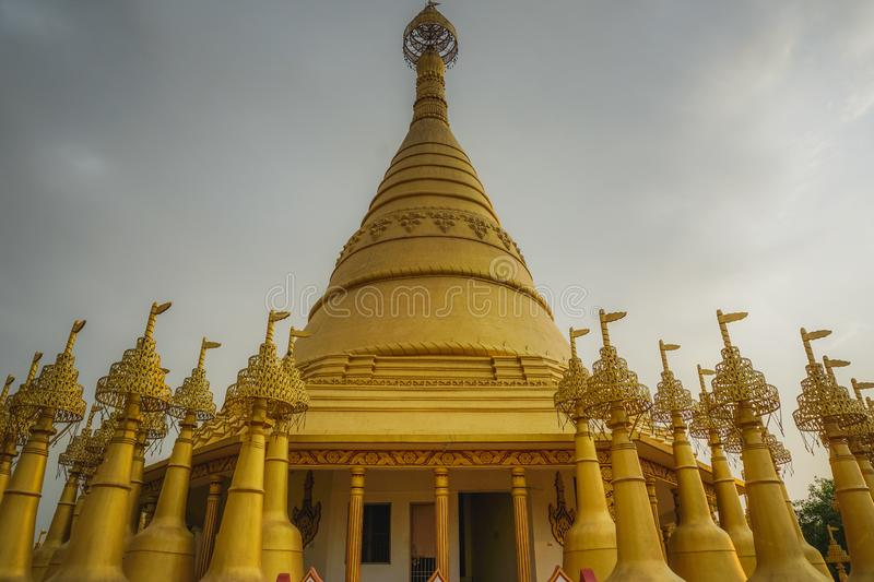 Beautiful golden pagodas in the center of Vipasana practice. Kanpur, India royalty free stock photography