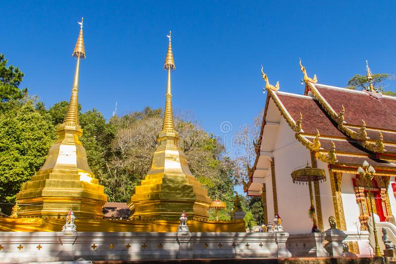 Beautiful golden pagodas at Wat Phra That Doi Tung, Chiang Rai. Wat Phra That Doi Tung comprises of a twin Lanna-style stupas, one. Of which is believed to royalty free stock photography
