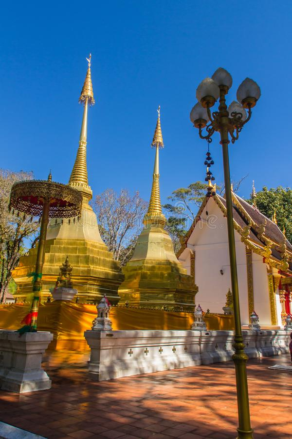 Beautiful golden pagodas at Wat Phra That Doi Tung, Chiang Rai. Wat Phra That Doi Tung comprises of a twin Lanna-style stupas, one. Of which is believed to stock photos