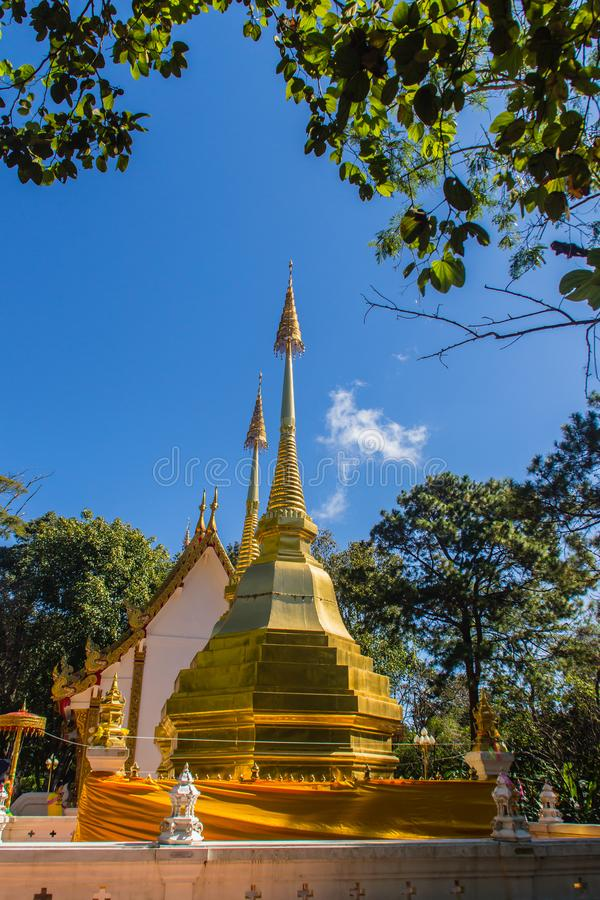 Beautiful golden pagodas at Wat Phra That Doi Tung, Chiang Rai. Wat Phra That Doi Tung comprises of a twin Lanna-style stupas, one. Of which is believed to royalty free stock photo