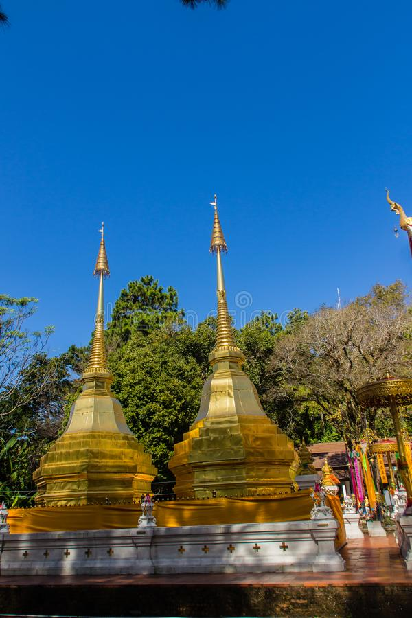 Beautiful golden pagodas at Wat Phra That Doi Tung, Chiang Rai. Wat Phra That Doi Tung comprises of a twin Lanna-style stupas, one. Of which is believed to stock image