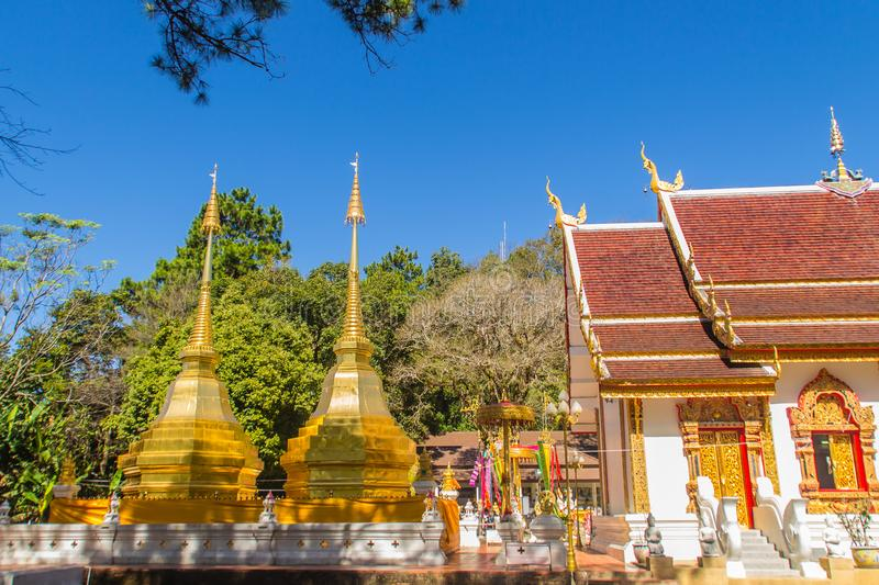 Beautiful golden pagodas at Wat Phra That Doi Tung, Chiang Rai. Wat Phra That Doi Tung comprises of a twin Lanna-style stupas, one. Of which is believed to royalty free stock photos