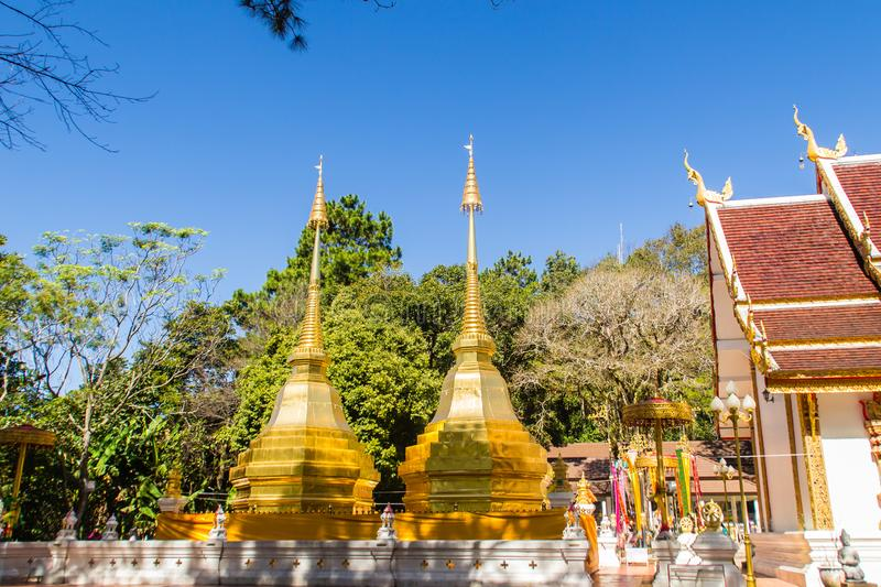 Beautiful golden pagodas at Wat Phra That Doi Tung, Chiang Rai. Wat Phra That Doi Tung comprises of a twin Lanna-style stupas, one. Of which is believed to stock photography