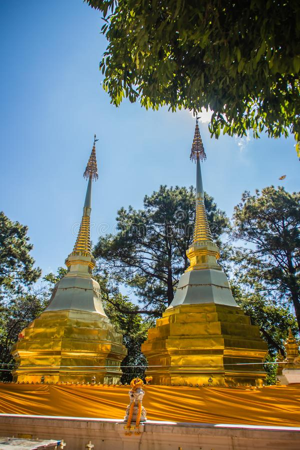 Beautiful golden pagodas at Wat Phra That Doi Tung, Chiang Rai. Wat Phra That Doi Tung comprises of a twin Lanna-style stupas, one. Of which is believed to stock photo