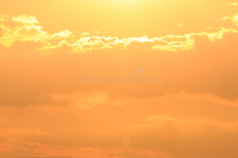 Beautiful Golden sky with cloud before sunset.  stock photo