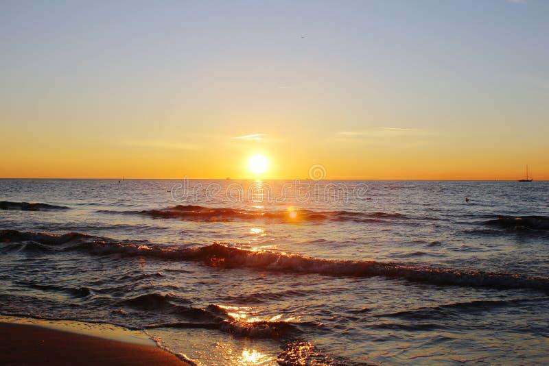 Beautiful golden sunset on the beach stock photos