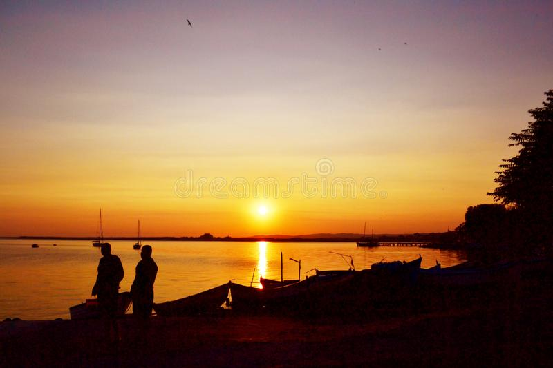 Beautiful Golden Sunset on the Lake with Fish Boats stock photography