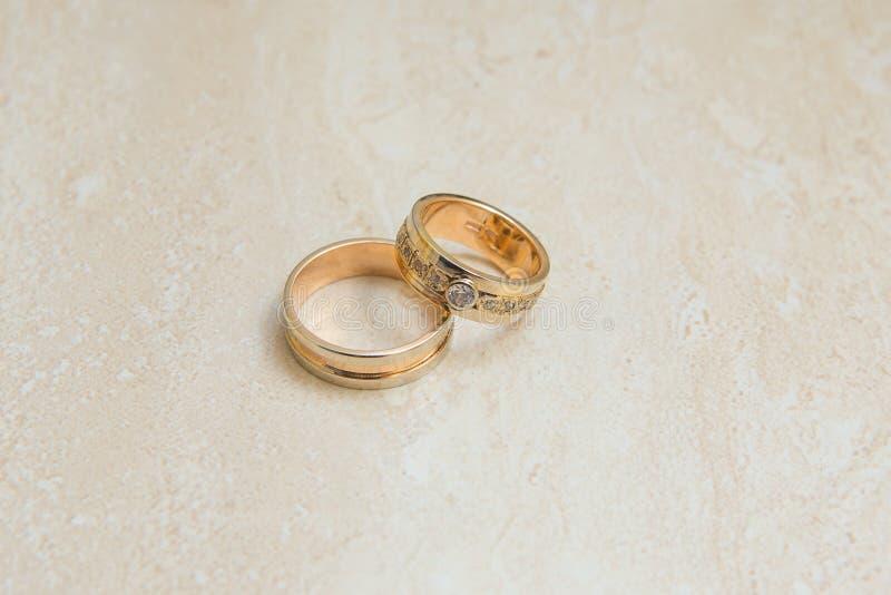 Beautiful golden wedding rings. Close up of beautiful golden wedding rings stock images