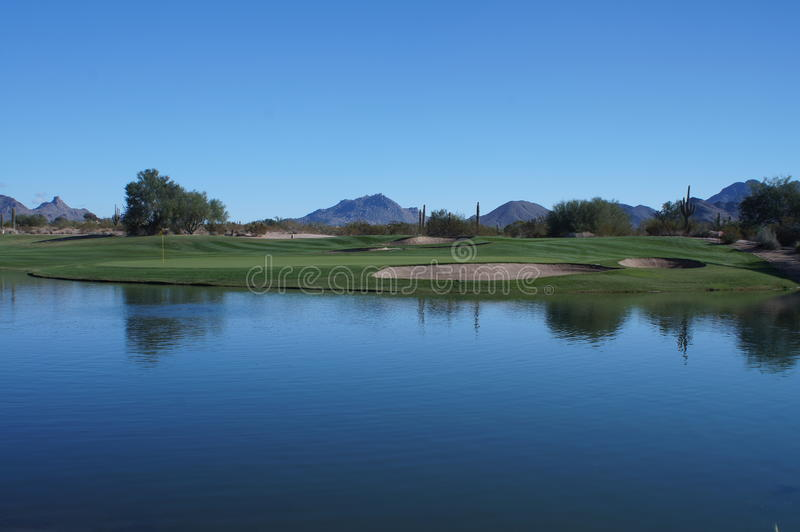 Beautiful Golf Course. Beautiful desert golf course with mountains and cactus in the background with a beautiful pond or lake in the forground stock images