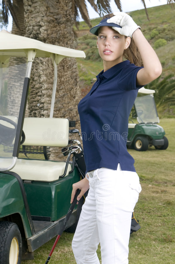 Beautiful golf player with her bogey in the golf f