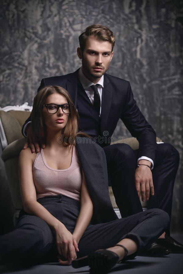 Fashionable man and woman stock photography