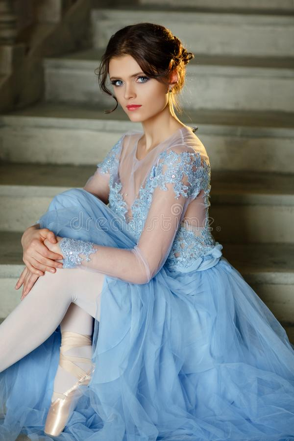 Free Beautiful Graceful Girl Ballerina In A Blue Dress And Pointe Is Stock Images - 112217514