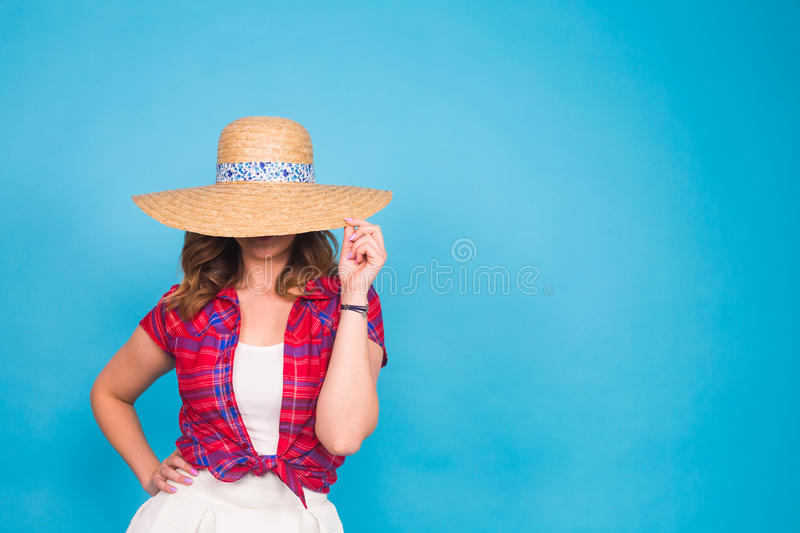 Beautiful graceful woman in elegant hat with a wide brim. Beauty, fashion concept. royalty free stock images