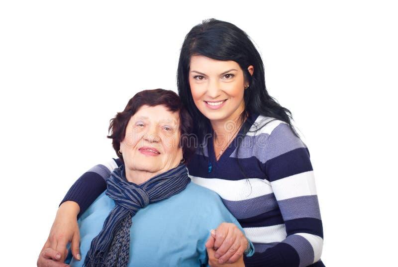 Beautiful granddaughter and grandma royalty free stock images