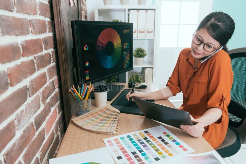 Beautiful graphic design company female employee royalty free stock image