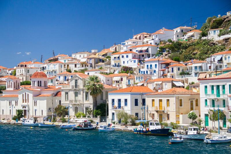 Beautiful greek island and boats royalty free stock photos