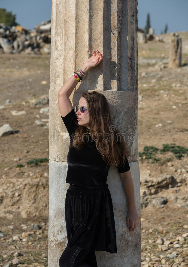 Beautiful Greek young girl holding an ancient vessel in ancient theatre of Thassos island, Greece royalty free stock photography