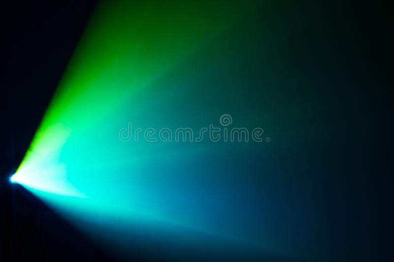 Beautiful green and blue shade color wide lens projector with light beam for movie and cinema at night . smoke texture spotlight stock photos