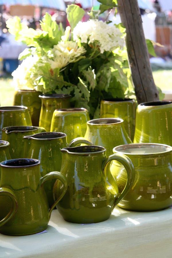 Ceramic jugs made by masters of Latvia. Beautiful green ceramic jugs from Latvian masters stock photos