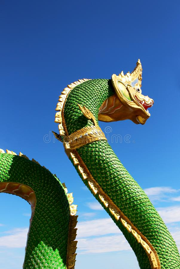 Beautiful Green colors of Praya Nark or Naga in Thai temple with colorful sky and sun flare effect on sunrise time. Beautiful Selective Focus Green colors Body royalty free stock image