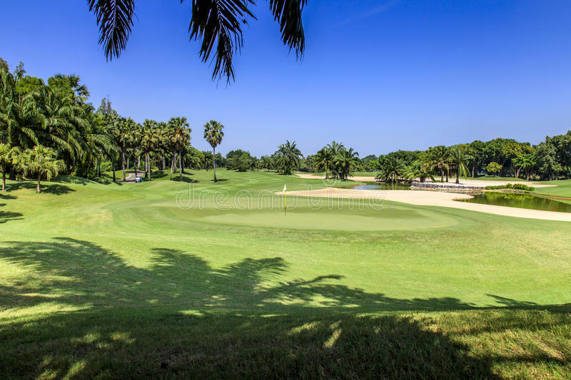 Beautiful green golf course on a sunny day, Thailand royalty free stock images