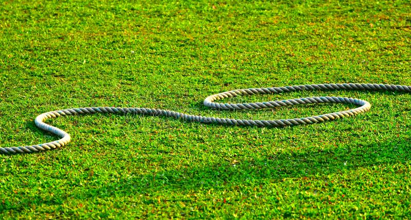 Cricket Ground Outfield with Rope Stock Background Photo. The beautiful green grass outfield of a cricket ground with the boundary white rope natural royalty stock photos