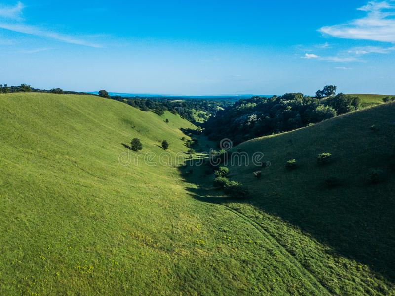 Beautiful green hills landscape in springtime stock images