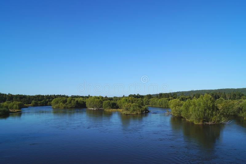 beautiful green islands on the river stock images