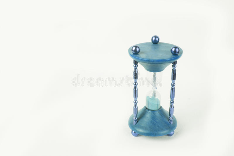 Beautiful green old timeglass / hour glass on white studio background stock photography