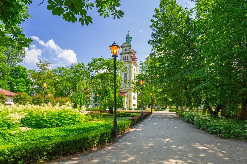 Beautiful green park with the old church in Sopot, Poland. Sea, summer, promenade, baltic, square, blue, sky, shadow, holiday, vacation, city, travel stock photos