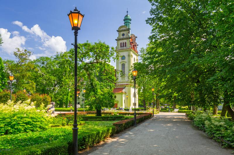 Beautiful green park with the old church in Sopot, Poland. Sea, summer, promenade, baltic, square, blue, sky, shadow, holiday, vacation, city, travel stock images