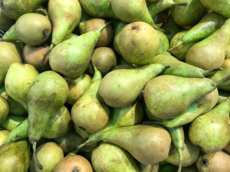 Beautiful green ripe southern natural sweet vitamin tasty oriental bright pears, fruit. Texture, background royalty free stock images