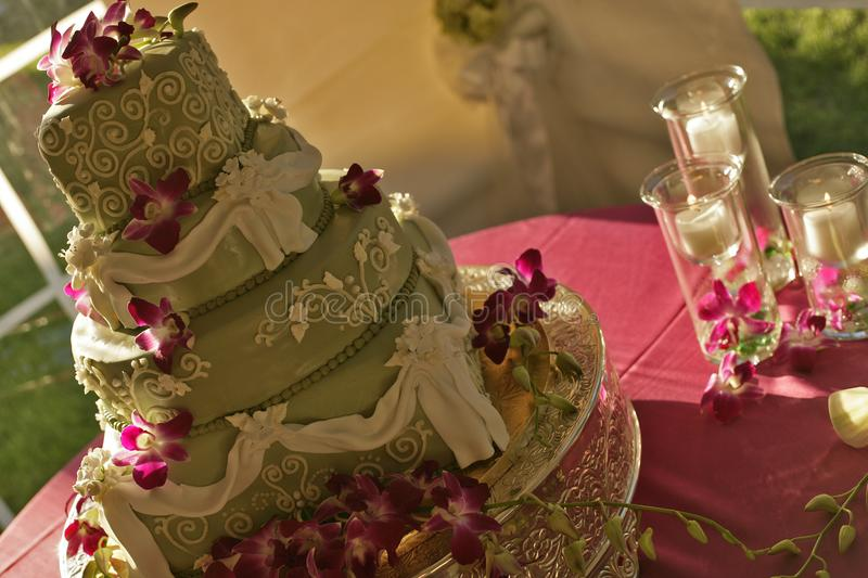 Big green wedding cake with candles royalty free stock photo